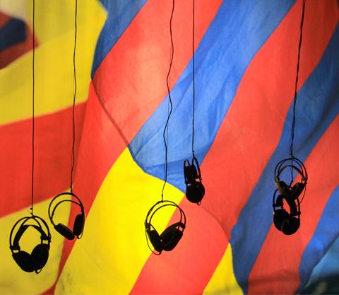 Image of headphones dangling in the air.